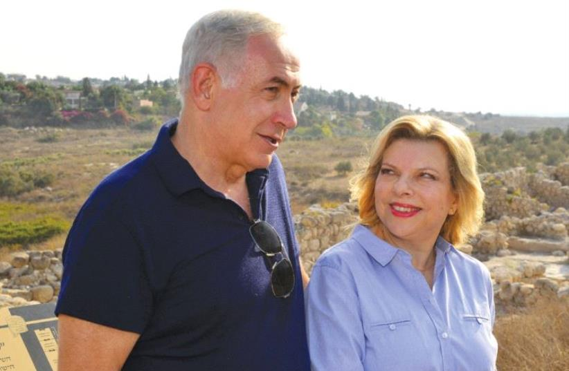 PRIME MINISTER Benjamin Netanyahu and his wife, Sara, visit the Tel Gezer archeological site on Friday. (photo credit: KOBI GIDEON/GPO)
