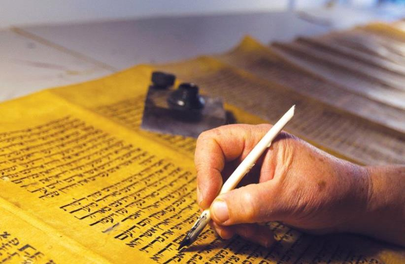 A torah scroll (photo credit: REUTERS)