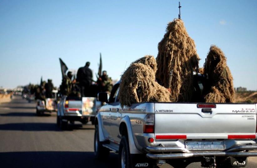 Arab militants parade in Rafah.  (photo credit: REUTERS)