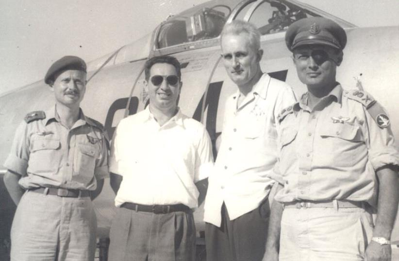 Shimon Peres (second left), director of the Ministry of Defense, is seen in the mid-1950s against the background of a French-supplied Dassault Ouragan fighter bomber (photo credit: IDF ARCHIVES, DEFENSE MINISTRY)
