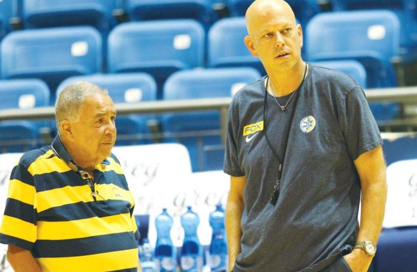 Maccabi Tel Aviv head coach Rami Hadar (right) speaks to chairman Shimon Mizrahi (photo credit: ADI AVISHAI)