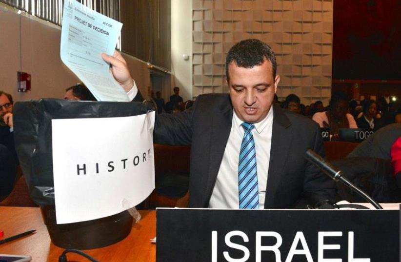 Israel's envoy to UNESCO Carmel Shama-Hacohen puts the resolution on Jerusalem in the trashbin of history (photo credit: EREZ LICHTFELD / PERMANENT MISSION OF ISRAEL TO THE UN)