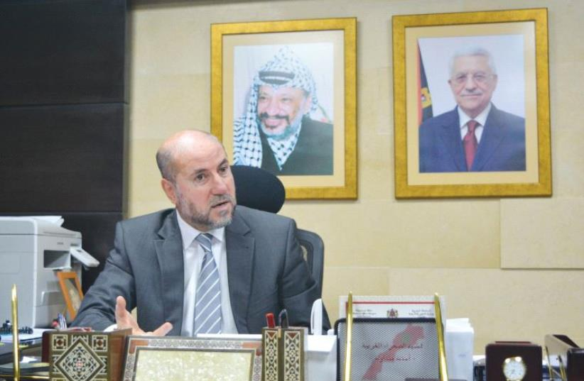 MAHMOUD AL-HABASH, top adviser to PA President Mahmoud Abbas, responds to questions during an interview yesterday in his office in northern Ramallah. (photo credit: UDI SHAHAM)