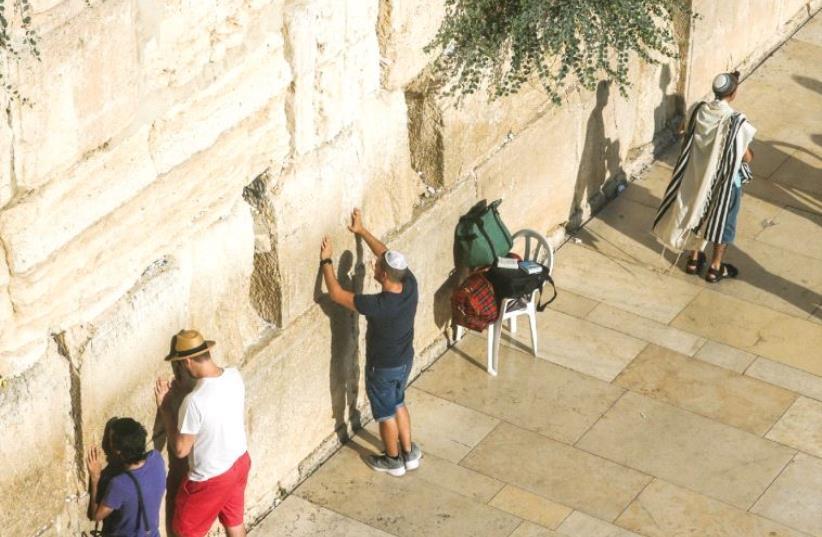 Praying at the Western Wall (photo credit: MARC ISRAEL SELLEM)