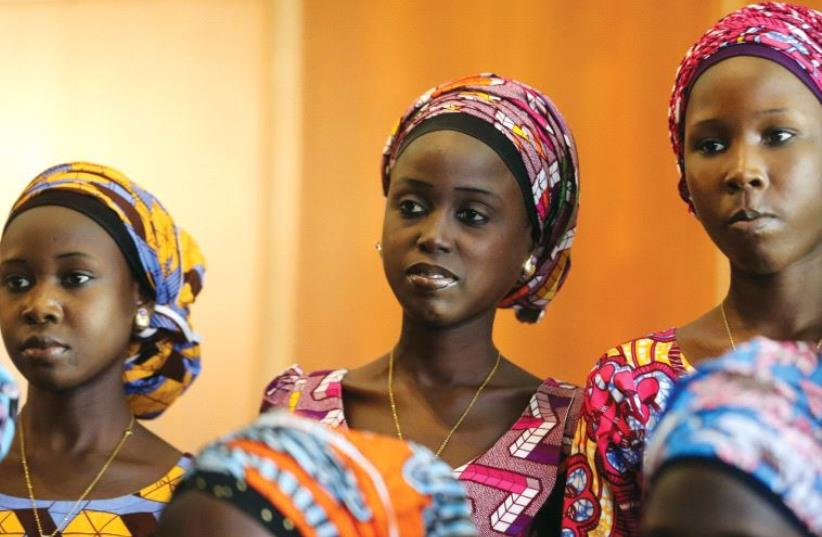 Some of the 21 Chibok schoolgirls released by Boko Haram look on during their visit to meet President Muhammadu Buhari in Abuja, Nigeria, on October 19 (photo credit: REUTERS)