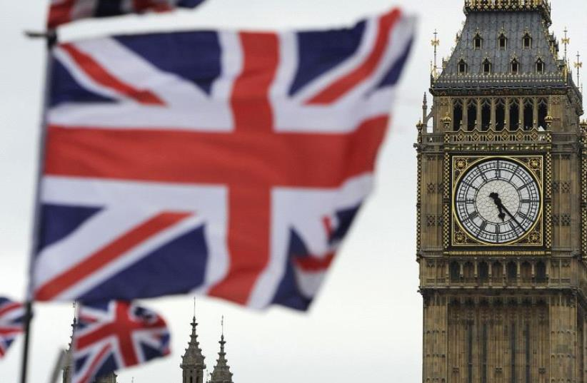 Flags are seen above a souvenir kiosk near Big Ben clock at the Houses of Parliament in central London (photo credit: REUTERS)