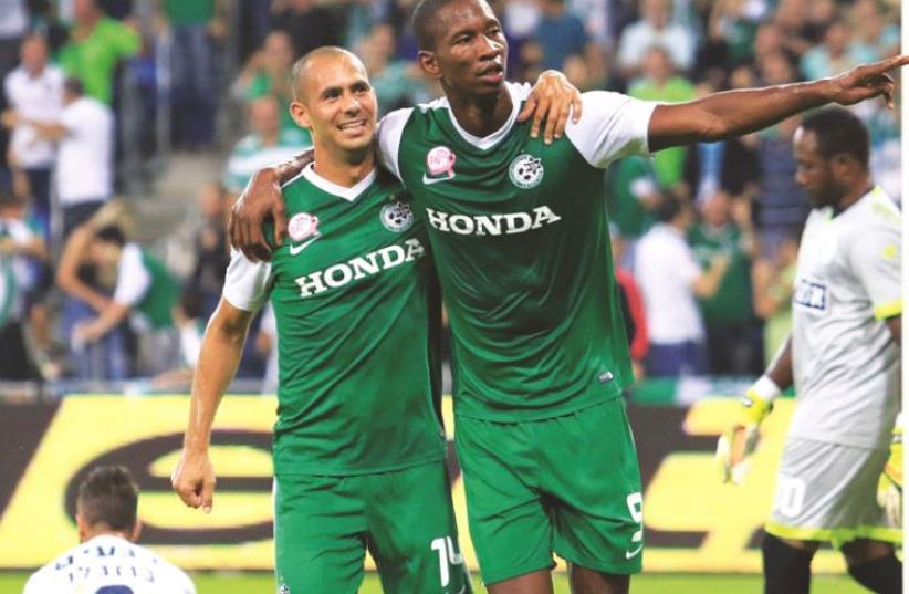 Maccabi Haifa players celebrating (photo credit: ERAN LUF)