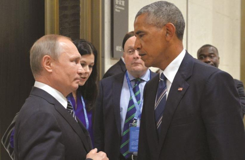 Poutine et Obama, face-à-face (photo credit: REUTERS)