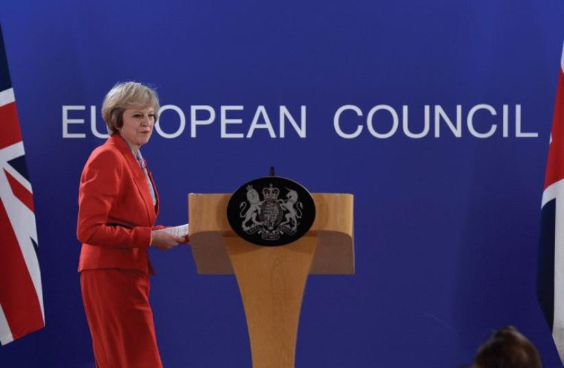 UK PRIME MINISTER Theresa May holds a news conference after the EU summit in Brussels on October 21. (photo credit: REUTERS)