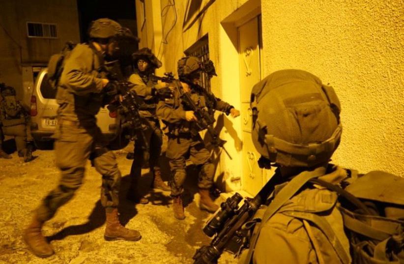 IDF forces raid home of terrorist. (photo credit: IDF SPOKESMAN'S UNIT)