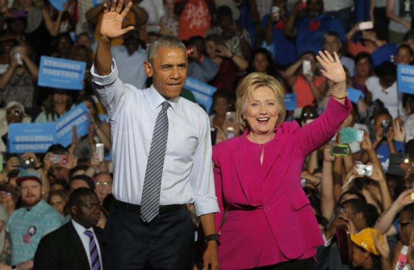 Barack Obama and Hillary Clinton at a campaign event (photo credit: REUTERS)