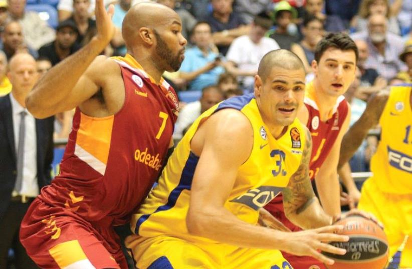 Maccabi Tel Aviv center Maik Zirbes (right) is still getting used to life at the club, averaging 9.3 points and 3.3 rebounds entering tonight's game against Barcelona at Yad Eliyahu Arena. (photo credit: ADI AVISHAI)