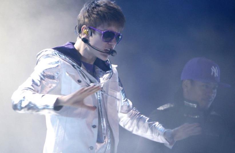 Justin Bieber performing during his 2011 concert in Tel Aviv (photo credit: REUTERS)