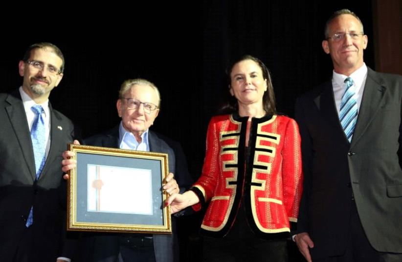 MORRIS KAHN (second left) receives the America-Israel Chamber of Commerce Lifetime Achievement Award from its chairwoman, Ofra Strauss, flanked by US Ambassador Daniel Shapiro (left) and AICC CEO Oded Rose. (photo credit: SIVAN FARAG)