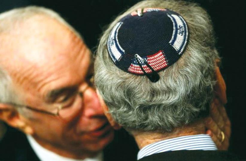 An American Jew wearing a kippa embroidered with the US and Israeli flags attends a Hanukka reception at the White House last year (photo credit: REUTERS)