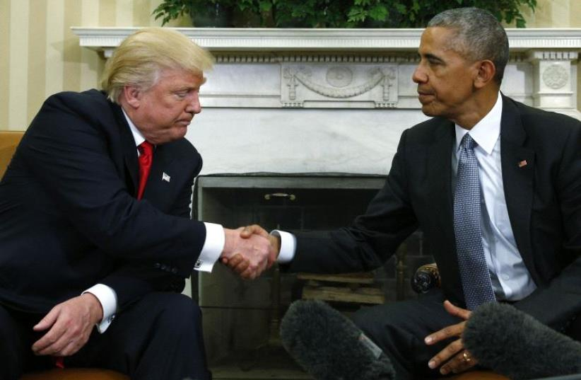 U.S. President Obama greets President-elect Trump in the White House Oval Office in Washington (photo credit: KEVIN LAMARQUE/REUTERS)