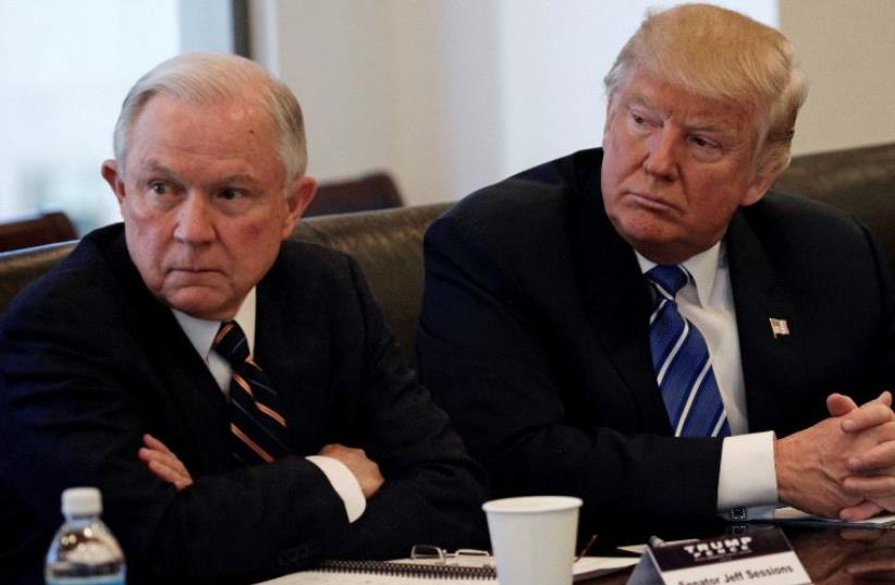 Donald Trump sits with Jeff Sessions at Trump Tower in Manhattan, New York (photo credit: REUTERS)