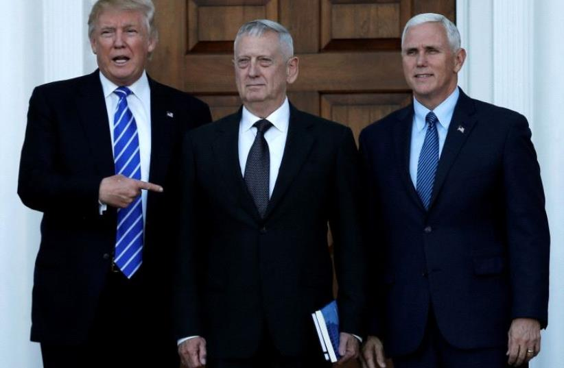 US President-elect Donald Trump (L) and Vice President-elect Mike Pence (R) greet retired Marine General James Mattis in Bedminster, New Jersey, US, (photo credit: REUTERS)