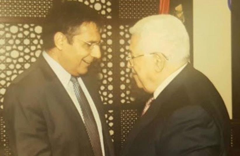 Zionist Union MK Yossi Yona and PA President Mahmoud Abbas shake hands in the Mukata in Ramallah. (photo credit: COURTESY OF PALESTINIAN AUTHORITY PRESIDENCY OFFICE)