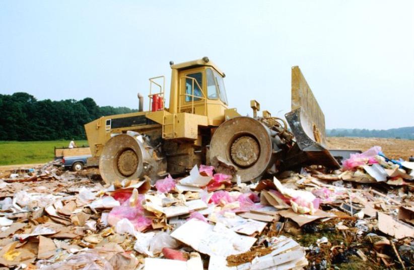 Bulldozer at garbage dump (photo credit: ING IMAGE/ASAP)