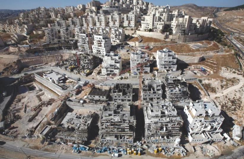 HOUSES UNDER construction in the Har Homa neighborhood of Jerusalem in 2010 (photo credit: REUTERS)