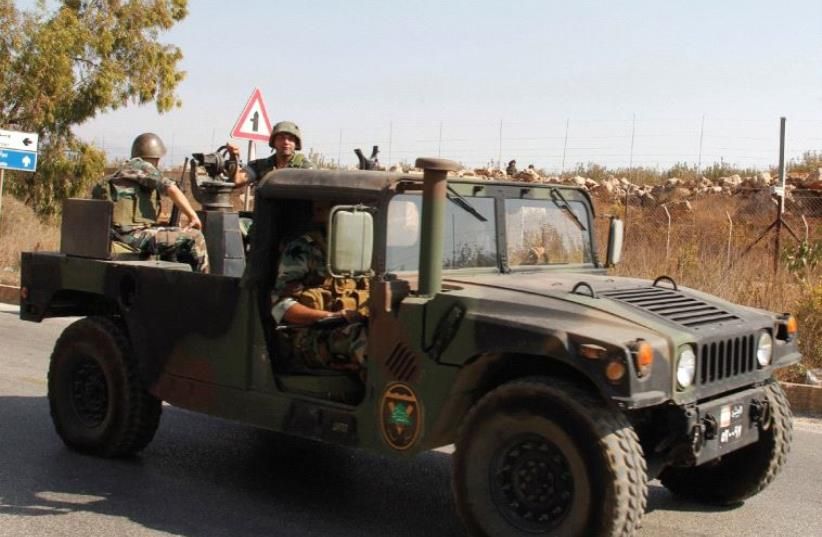LEBANESE SOLDIERS drive near the border with Israel in Kafr Kila, in October. Israel has used its ability to operate in the skies over Syria to prevent weapons transfers to Hezbollah in Lebanon from the Syrian regime. (photo credit: REUTERS)