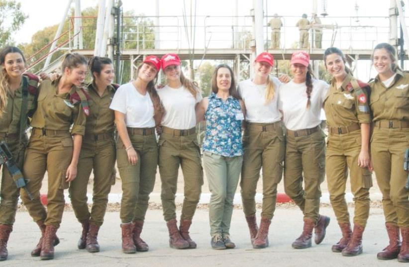 RONIT BURDETTE (center), the IDF's first female parachuting instructor, poses recently with a class of today's women instructors (photo credit: IDF)