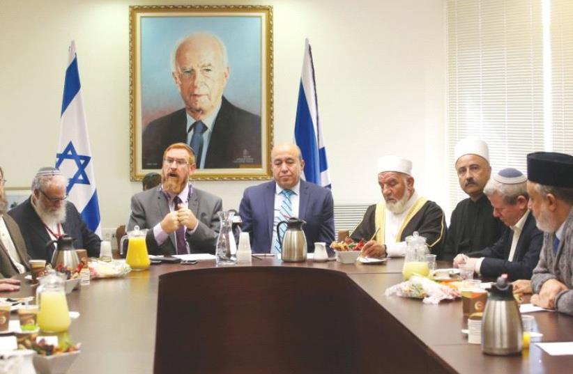 MKS YEHUDAH GLICK (rear left) and Zuheir Bahloul lead a conference at the Knesset yesterday, which was called in response to a proposal to ban religious institutions from using outdoor loudspeakers (photo credit: MARC ISRAEL SELLEM/THE JERUSALEM POST)