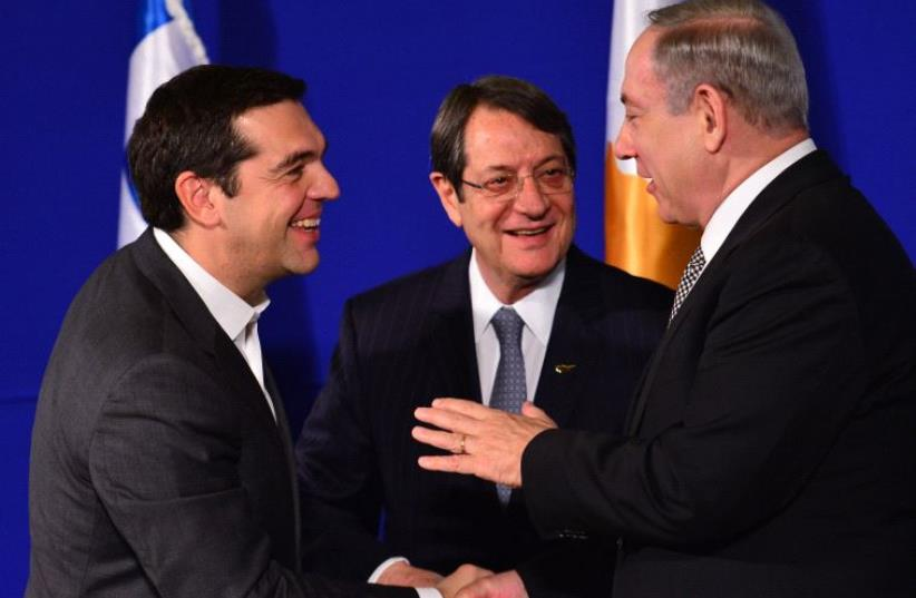 Israeli PM Netanyahu, Greek PM Tsipras and Cyprus President Anastasiades in a trilateral summit (photo credit: KOBY GIDEON/GPO)