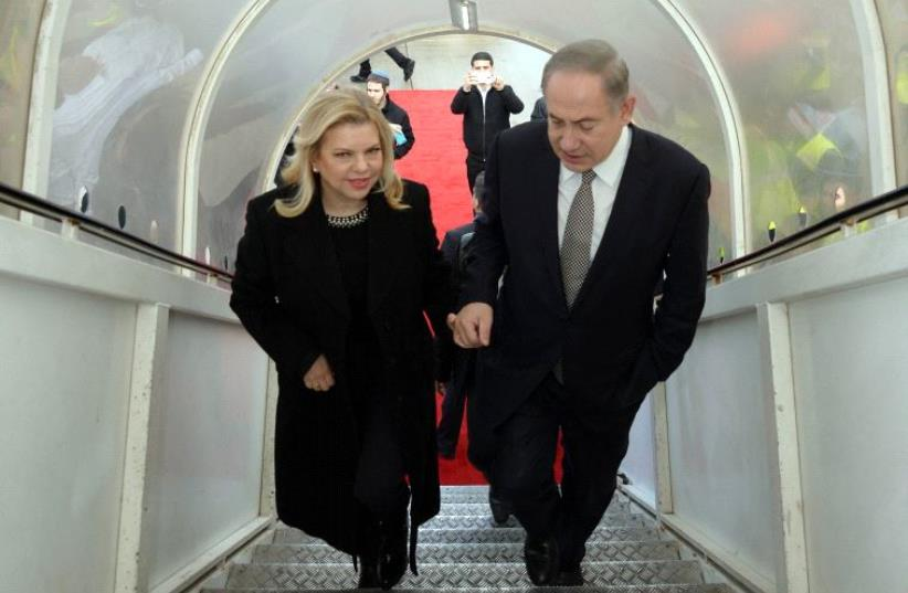 Prime Minister Benjamin Netanyahu and his wife Sara Netanyahu en route to Azerbaijan and Kazakhstan. (photo credit: CHAIM TZACH/GPO)
