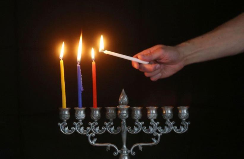 Lighting of the Hanukkah menorah  (photo credit: MARC ISRAEL SELLEM/THE JERUSALEM POST)