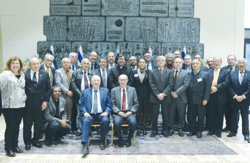 PRESIDENT REUVEN RIVLIN and Hebrew University President Menachem Ben-Sasson (also seated) meet with heads of Latin American universities in the capital. (photo credit: MARK NEYMAN / GPO)