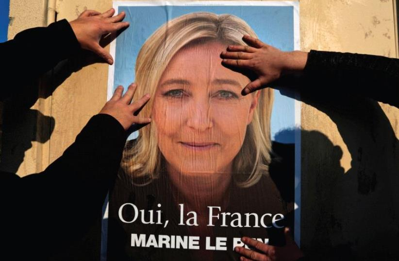 SUPPORTERS OF Marine Le Pen put up a poster earlier this year. There has been a meteoric rise of right-wing movements in Europe, writes the author. (photo credit: REUTERS)