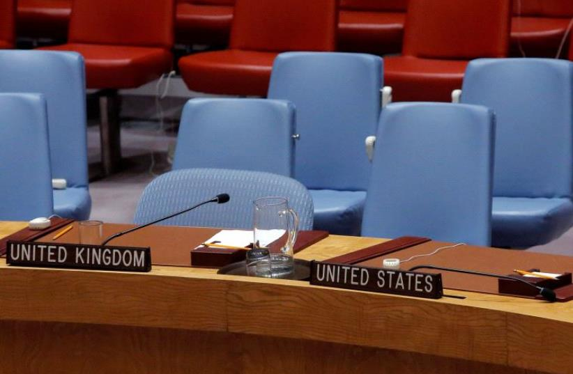 The seats of Britain and the United States sit empty in the United Nations Security Council chamber. (photo credit: REUTERS)