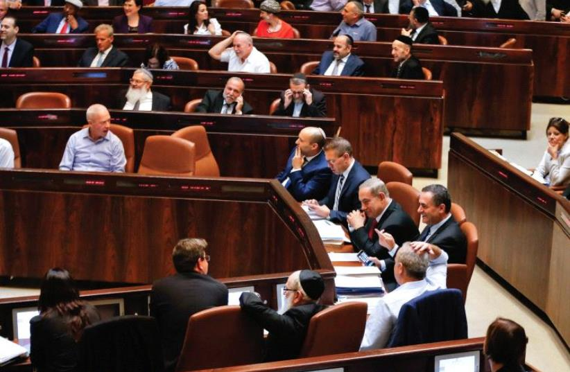 SHOW US the money. Lawmakers attend a preliminary vote on a bill at the Knesset (photo credit: REUTERS)