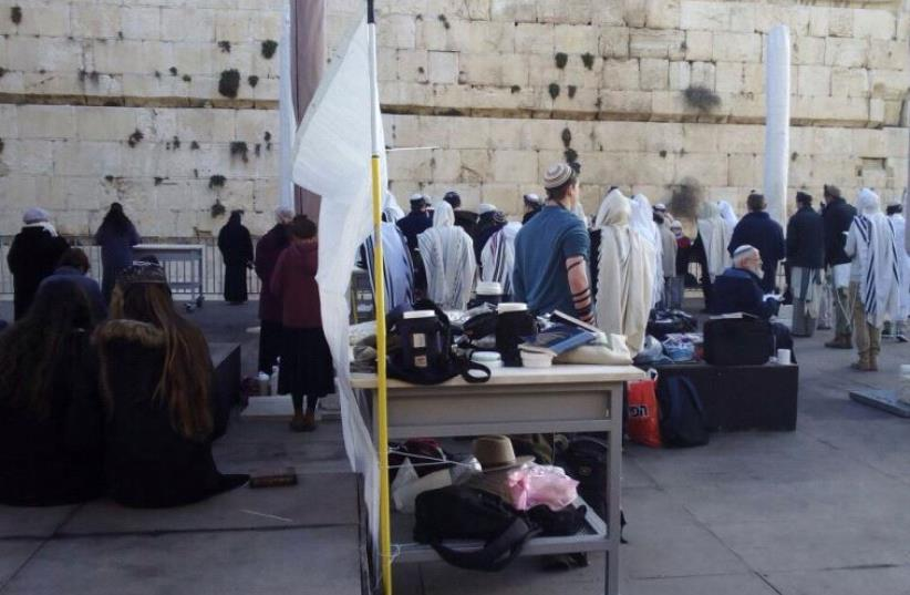An impromptu Orthodox prayer service at the pluralist section of the Western Wall in Jerusalem. (photo credit: YIZHAR HESS)