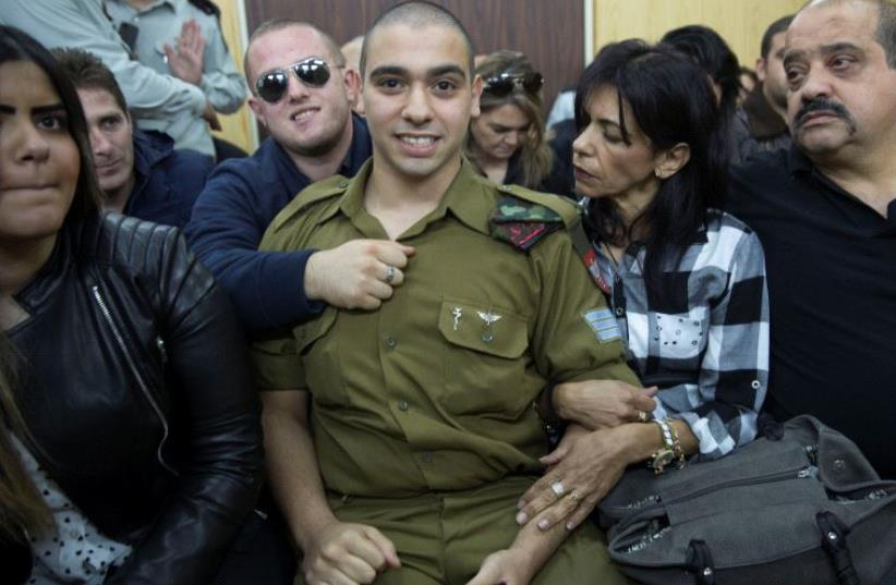 Elor Azaria sits to hear his verdict in a military court in Tel Aviv, Israel, January 4, 2017 (photo credit: REUTERS)
