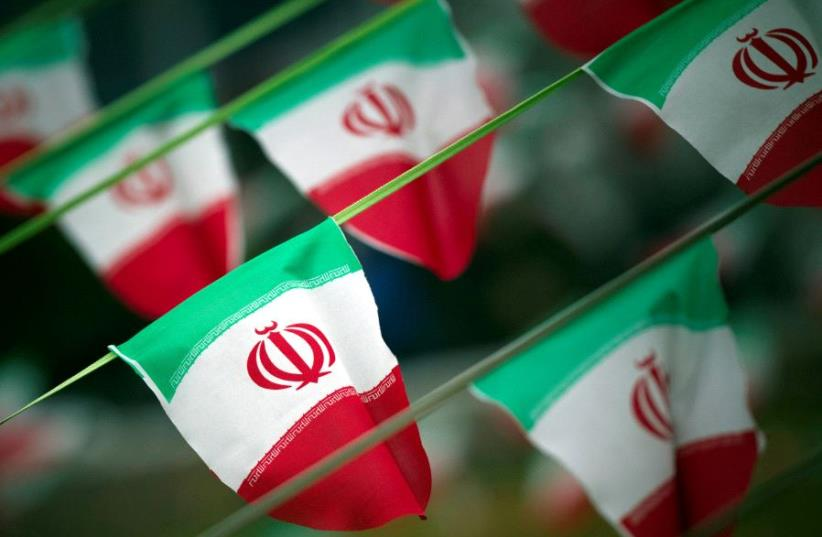 Iran's national flags are seen on a square in Tehran, Iran. (photo credit: REUTERS)