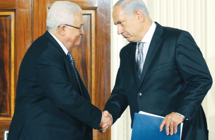 PM Netanyahu and President of the Palestinian Authority Mahmoud Abbas in Washington, 2010 (photo credit: GPO)