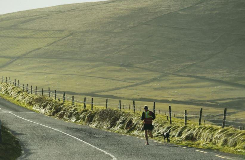 Running (photo credit: REUTERS)