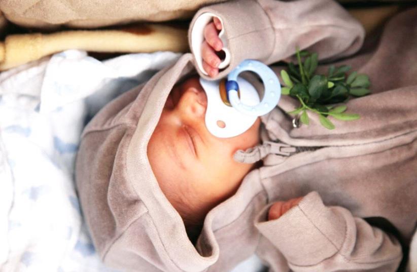 New born baby (photo credit: ILLUSTRATIVE: MARC ISRAEL SELLEM)