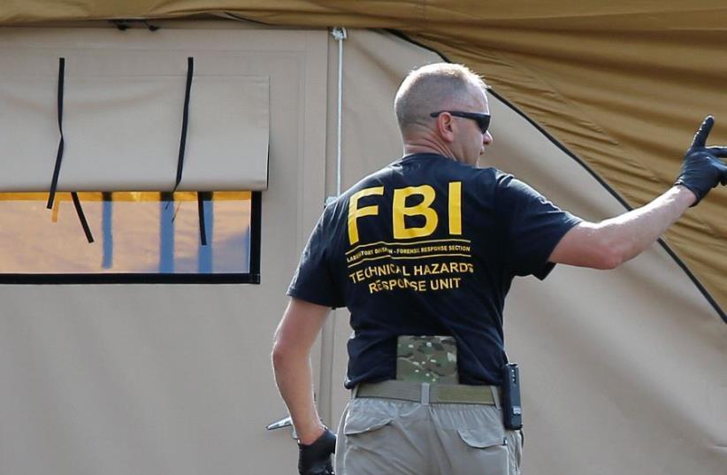 An FBI investigator  (photo credit: REUTERS)