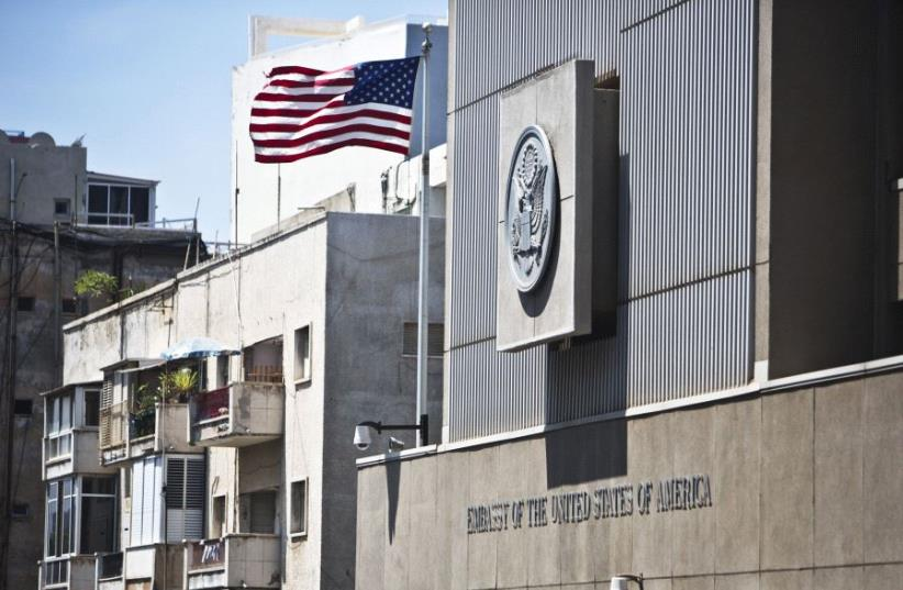A flag flutters outside the US embassy in Tel Aviv August 4, 2013 (photo credit: REUTERS)