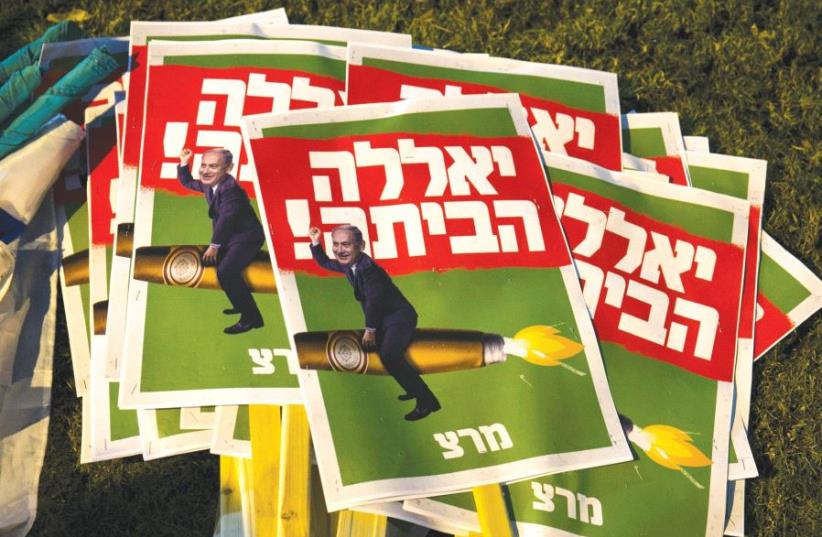 SIGNS READING 'Go Home' are seen before a left-wing protest calling for the resignation of Prime Minister Benjamin Netanyahu in Tel Aviv (photo credit: REUTERS)