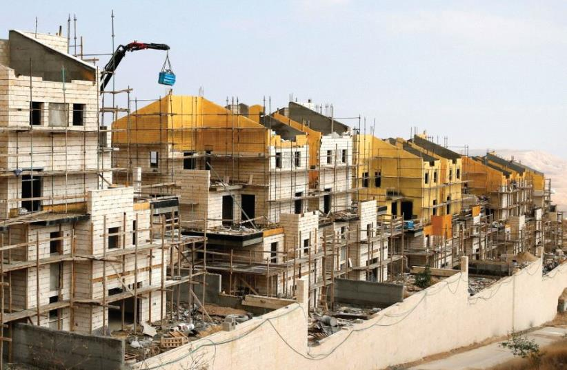 BULIDINGS ARE SEEN under construction in the settlement of Ma'aleh Adumim [File] (photo credit: REUTERS)