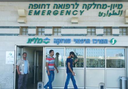 MEN EXIT the emergency room at Soroka University Medical Center in Beersheba.