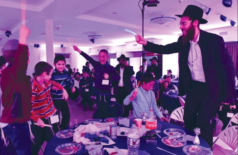 Some boys dance with their teacher Rabbi Yishai Dinerman at the annual 'Day of Celebration.' (photo credit: SHMUEL AMIT)
