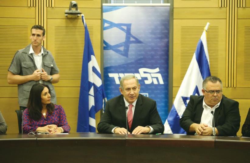 Culture Minister Miri Regev, Prime Minister Netanyahu and MK David Bitan in the Knesset in November (photo credit: MARC ISRAEL SELLEM)