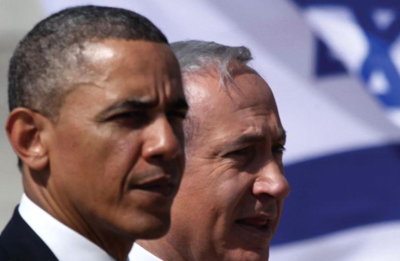 PRIME MINISTER Benjamin Netanyahu stands with President Barack Obama (photo credit: MARC ISRAEL SELLEM/THE JERUSALEM POST)