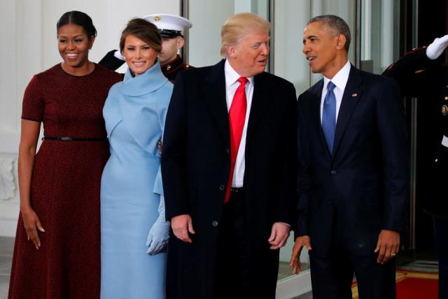 US President Barack Obama (R) and first lady Michelle Obama (L) greet US President-elect Donald Trump and his wife Melania for tea before the inauguration at the White House. (photo credit: REUTERS)